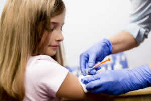 Vaccine - a doctor giving vaccination girl, health, prevention